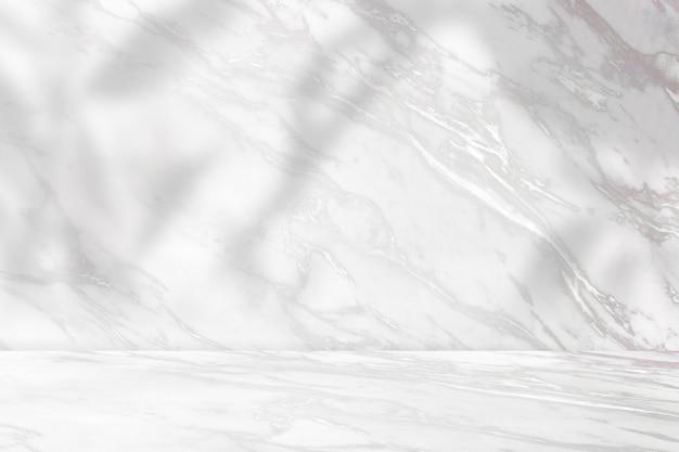 Pano de fundo de produto em mármore com sombra de planta