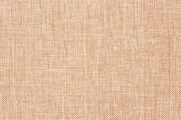 Pano de lona, estopa, decoração rústica. juta natural, textura. fundo abstrato marrom claro têxtil.