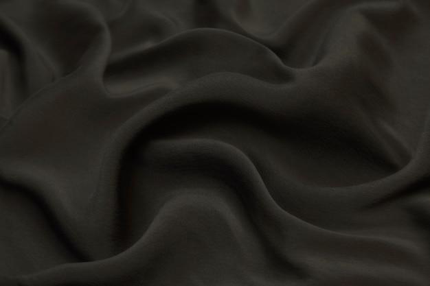Pano de luxo abstrato ou onda líquida de material de veludo de cetim de textura de seda grunge ou luxuoso.