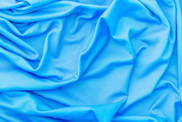 Pano de tecido azul, textura de poliéster, fundo de desgaste do esporte