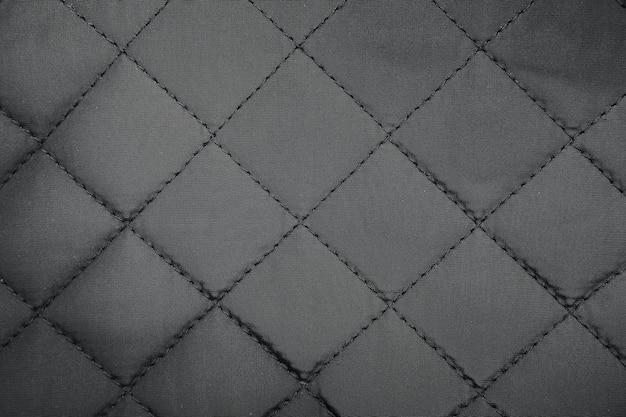 Pano em losango. fundo acolchoado de textura de tecido sintético.