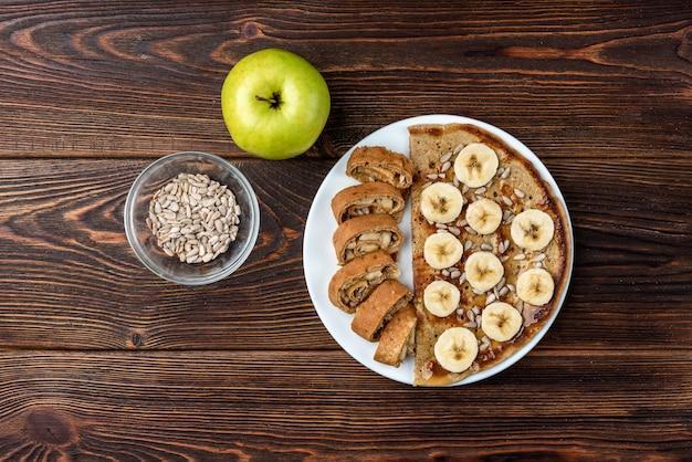 Panqueca de aveia com sementes de girassol e banana