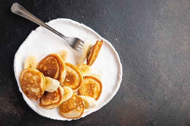 Panquecas banana café da manhã fatia de fruta xarope mel delicioso doce sobremesa porção fresca refeição lanche