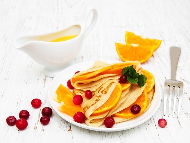 Panquecas com laranjas e cranberries