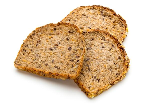 Pão de trigo integral assado, ingredientes biológicos, saudável com sementes.
