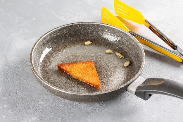 Pão frito em calda de açúcar