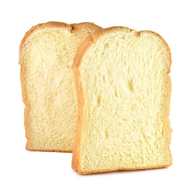 Pão, manteiga isolado no branco