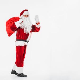 Papai Noel mostrando o gesto de saudação