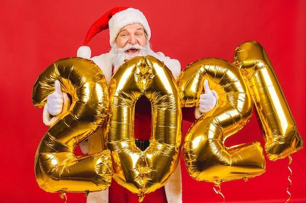 Papai noel segurando balões 2021