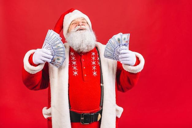 Papai noel segurando dinheiro