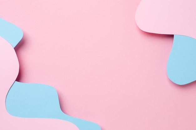 Papel abstrato cortado arte de ondas em rosa e azul