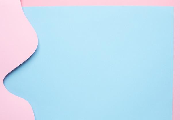 Papel abstrato cortado arte de ondas rosa em azul