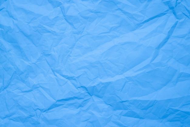 Papel amassado com textura de papel da moda na cor azul claro