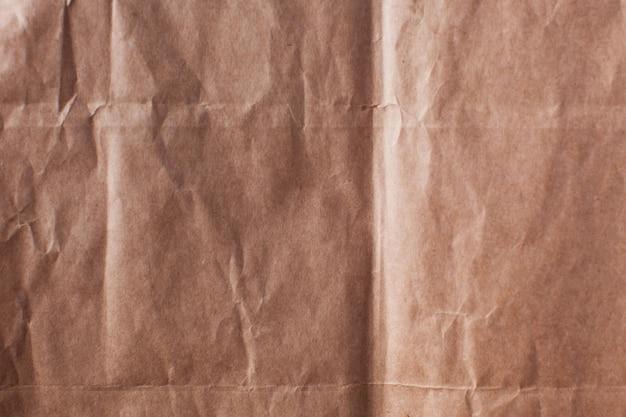 Papel amassado em toda a moldura. fundo texturizado