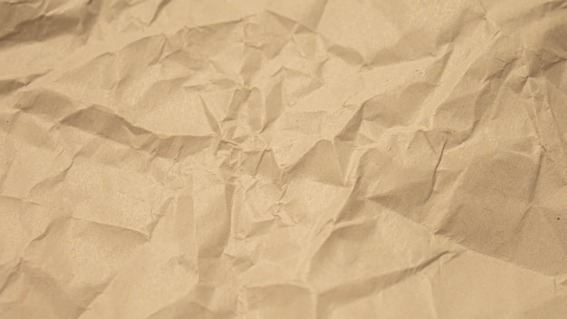 Papel amassado marrom close-up fundo de textura