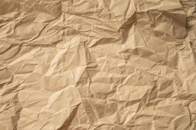 Papel amassado marrom close-up fundo de textura