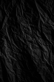 Papel amassado preto escuro fechar fundo de textura