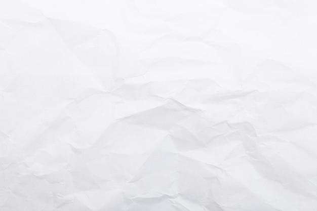 Papel branco amassado. plano de fundo para o design