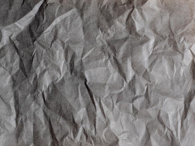 Papel cinza amassado. textura de papel. cópia spase, vista superior.