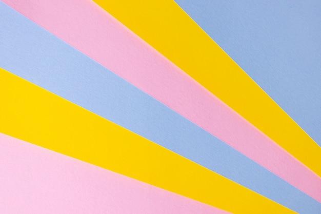 Papel colorido, cores pastel, azul, amarelo, rosa. imagem do espaço.