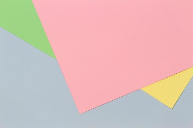 Papel cor-de-rosa amarelo verde pastel azul cor de fundo plano geométrico