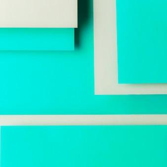 Papel de cartão cinza e turquesa em forma geométrica