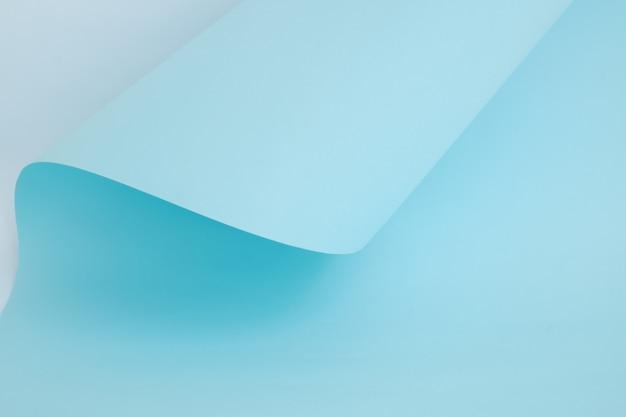 Papel de cor azul clara abstrata em formas geométricas