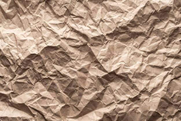 Papel de embalagem marrom de fundo amarrotado. fundo do espaço da cópia em branco.