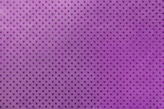 Papel de folha de metal roxo escuro com um padrão de estrelas