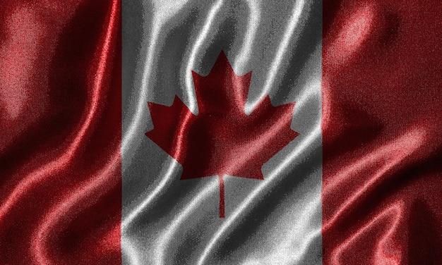 Papel de parede pela bandeira de canadá e bandeira de ondulação pela tela.