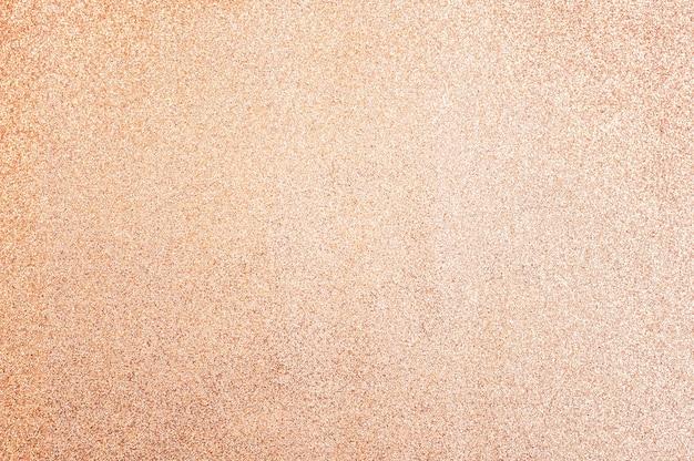 Papel de purpurina pêssego, close-up. fundo