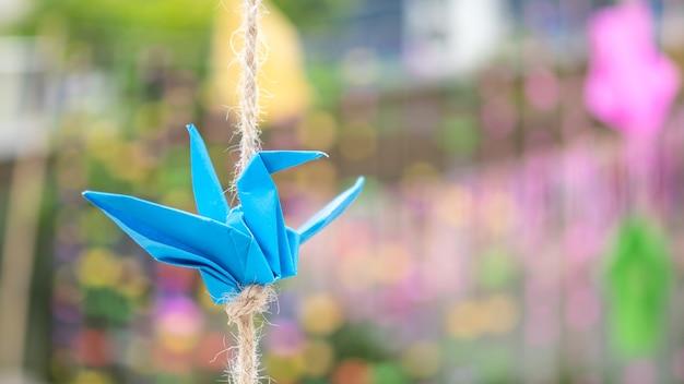 Papel dobrável de pássaros