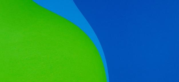 Papel geométrico cortado fundo de banner de papel de cor verde azul e ciano