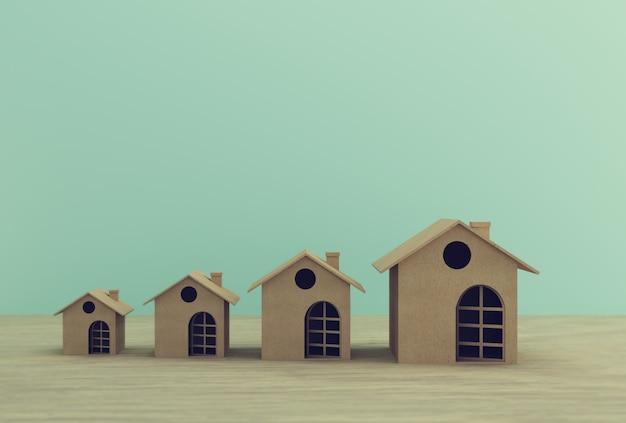 Papel modelo em casa na mesa. propriedade de investimento imobiliário e hipoteca da casa financeira. idéia de conceitos mínimos.