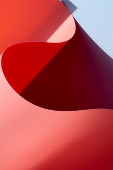 Papel monocromático curvado abstrato rosa