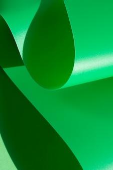 Papel monocromático curvado abstrato verde