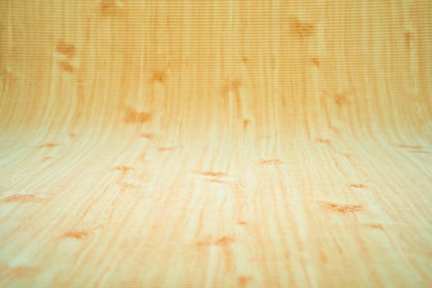 Papel ondulado com curva de fundo de padrão de madeira no conner para o fundo do infinito.
