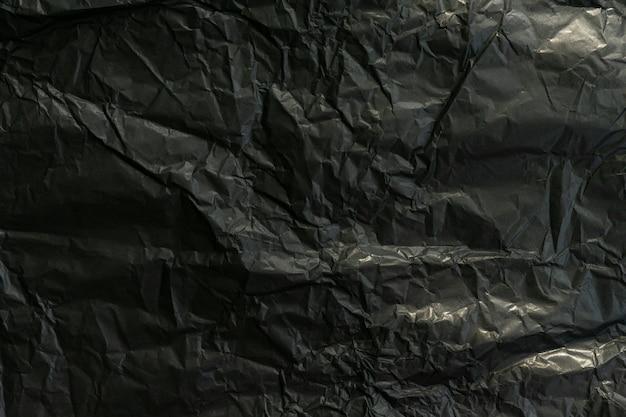 Papel preto amassado. fundo abstrato