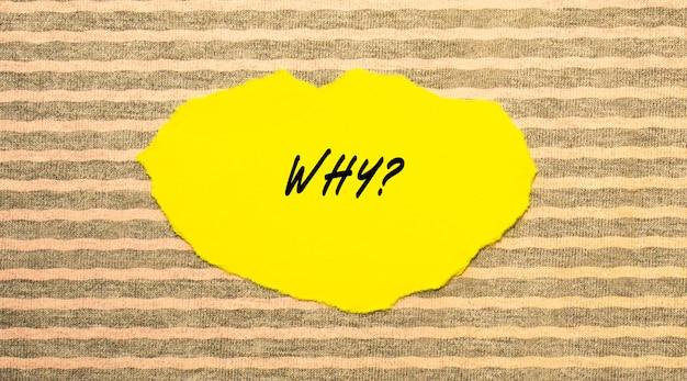 Papel rasgado amarelo com o texto por que.