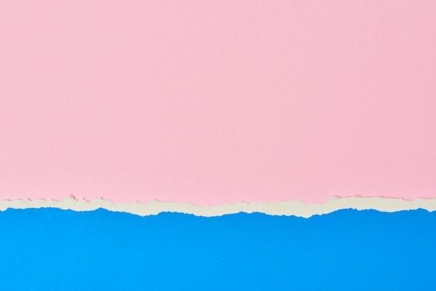 Papel rasgado rasgado nas cores rosa e azul