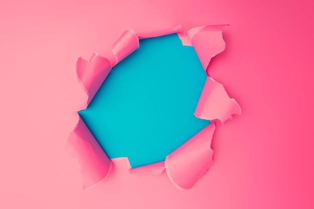 Papel rasgado rosa vivo. fundo do buraco de estouro. conceito de papel de parede colorido abstrato mínimo.