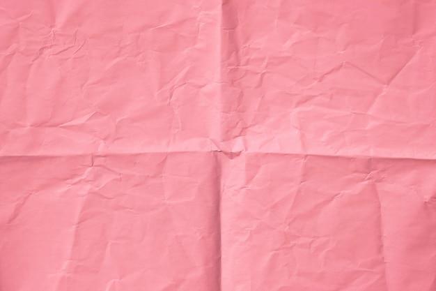 Papel rosa, vista superior do fundo de papel rosa amassado