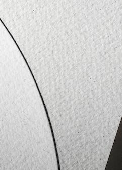Papel texturizado de corte branco em close-up