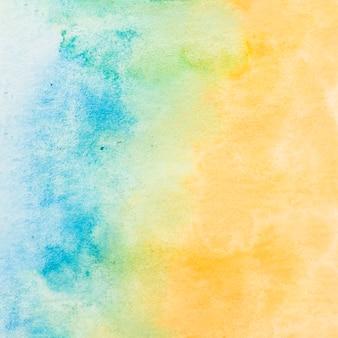 Papel texturizado pintado com fundo de cor azul e amarelo água