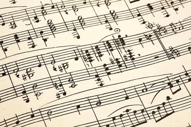 Papel velho com partituras vintage