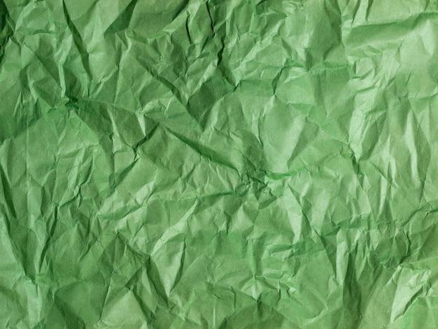 Papel verde amassado. textura de papel. cópia spase, vista superior.