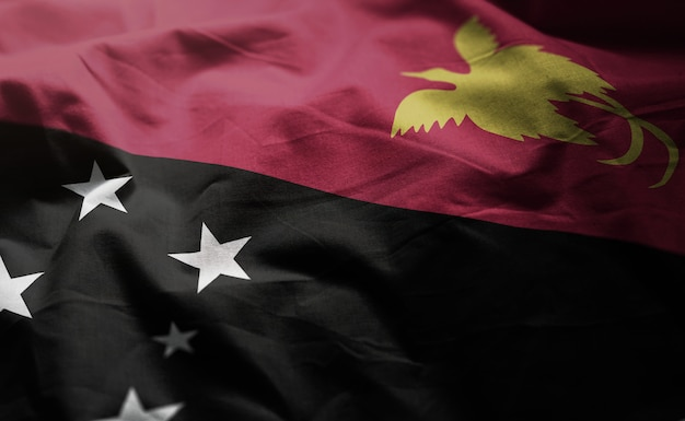 Papua nova guiné bandeira amarrotada close up