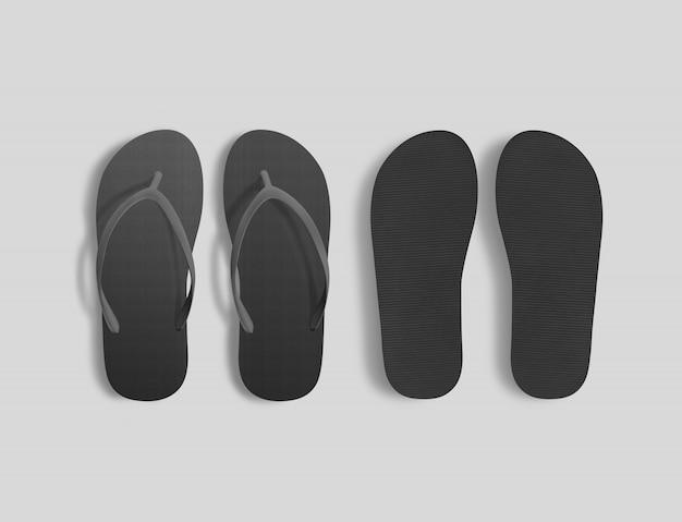 Par de chinelos de praia preto em branco, vista superior