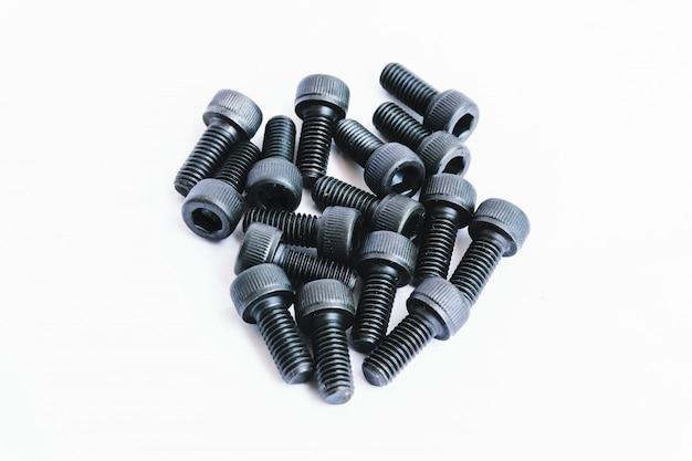 Parafusos de máquina pretos muito importantes para a montagem de componentes em branco