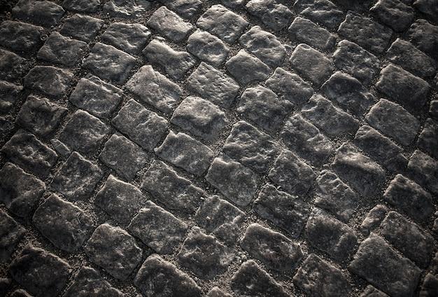 Paralelepípedos de granito do pavimento de blocos